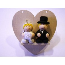 Bride & groom on hanging wooden heart
